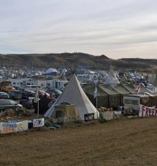 Photo of large outdoor encampment in rolling hills.