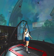 In the STRIVE Center, an immersive virtual reality facility overseen by the Biotechnology and Human Systems Division at Lincoln Laboratory, researchers collect data as a user tests a prototype ankle exoskeleton.