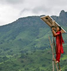A solar engineer maintains the street lighting in her village of Tinginaput, India — a rural area not connected to the region's main electrical grid.